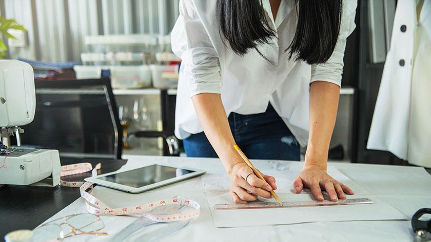 designer measuring patterns in her studio