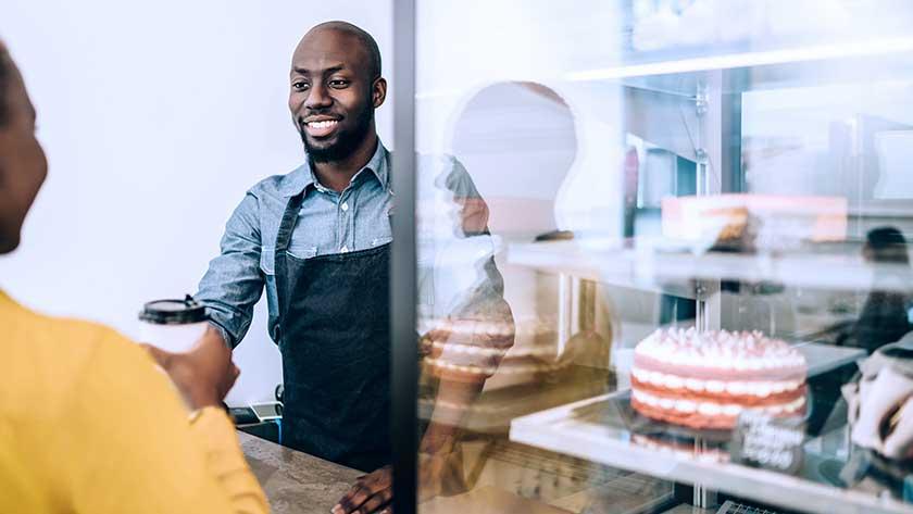 man serving customer at a bakery