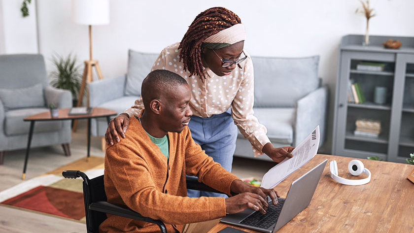 business partners looking at laptop