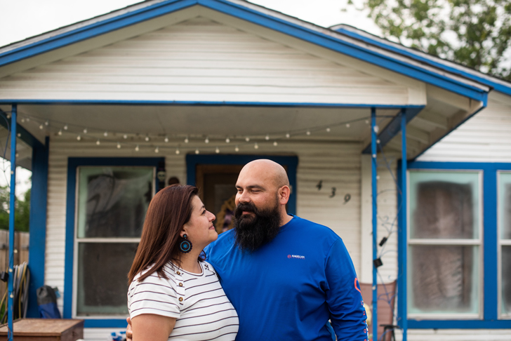 Zenaida and her husband, Antonio, in front of their house.