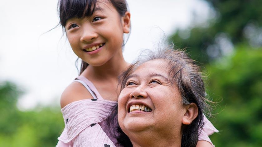 grandma and granddaughter playing outside