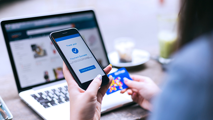 woman holding phone online purchase